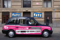 A taxi-side advertisement for the Bible Society's Riddle Of Life campaign