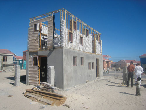 Freedom Park in Cape Town, South Africa, and a lowcost home built on the site, designed by Luyanda Mpahlwa for Design Indaba's 10x10 housing project