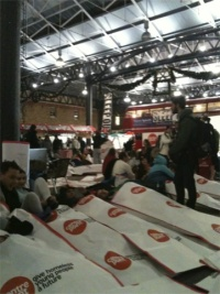 Centrepoint's supporter tuck into their cardboard sleeping bags