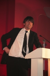 Host Alex James