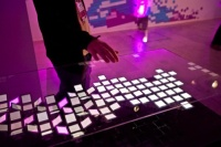 A festival-goer tries out the Jason Bruges Studio installation at the Internet Week Europe HQ at last year's festival