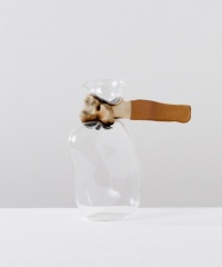 Bone Jar: Mouth blown glass on a cow bone, cow leather.