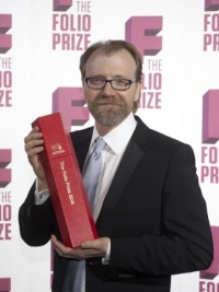 George Saunders collects his award last night