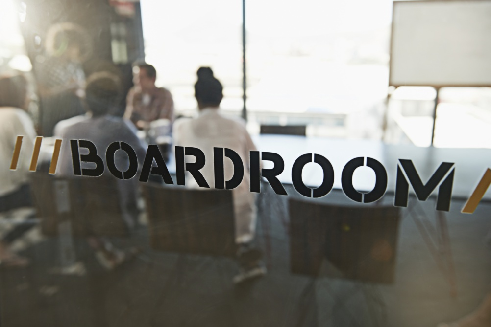 Shot of a group of young business colleagues in a boardroom meeting